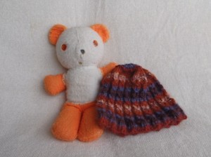 My first teddy bear, posing here with a knitted toque